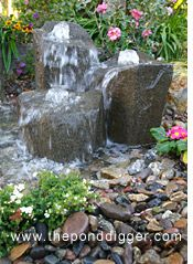 Papercrete boulders in a rock column fountain.... Hmmmmmm may need to try this too.