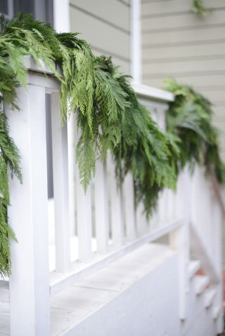 {Garland decorating outdoor stairs}