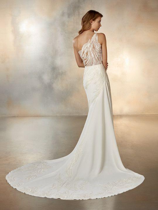 One Shoulder Crepe Sheath Wedding Dress With Beaded Detail Kleinfeld Bridal Pronovias Wedding Dress Wedding Dresses Flowing Wedding Dresses