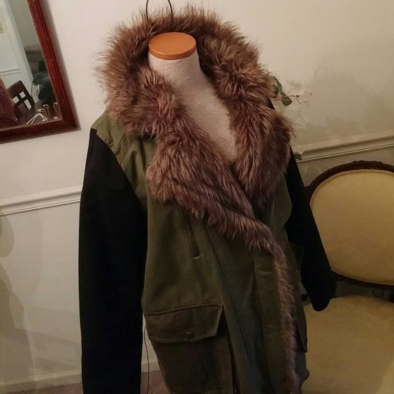 FOREVER 21 COAT The coat is very cute. Army green and black on sleves. A zipper on sleve end. 2 pockets on bottom and 2 zip pockets on top. Zipper front with tie on bottom. Only worn a couple of times. Forever 21 Jackets & Coats
