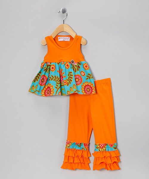 This pair is perfect for a petite sweet in need of a colorful ensemble. A winning combination of fun and functionality, the darling dress boasts an easy slip-on silhouette and gentle cotton feel. Not to be outdone, the pants feature an elastic waistband and tiers of ruffles that give the set a frilly finishing touch.Includes dress and pants100% cotton