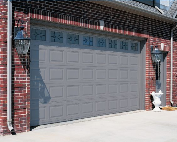 Red Brick House With a Garage Door And Front Door Color Gray And ...