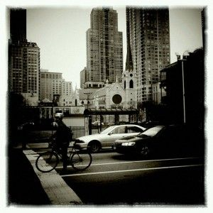 Daily commute. Near Chicago & State, Holy Name Cathedral in the background.
