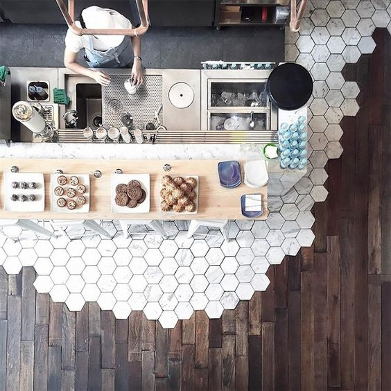 """Renovating a studio apartment can often feel like it's fraught with spatial issues, but we've got good news: This trend is made for small homes. """"I think this type of floor treatment is most...:"""
