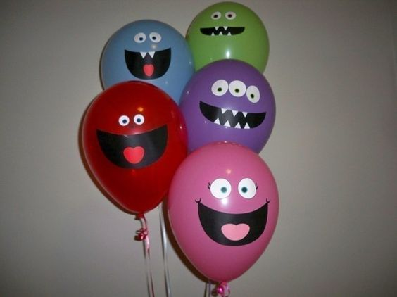 monster faces for balloons (cut out with cricut vinyl and stick on)