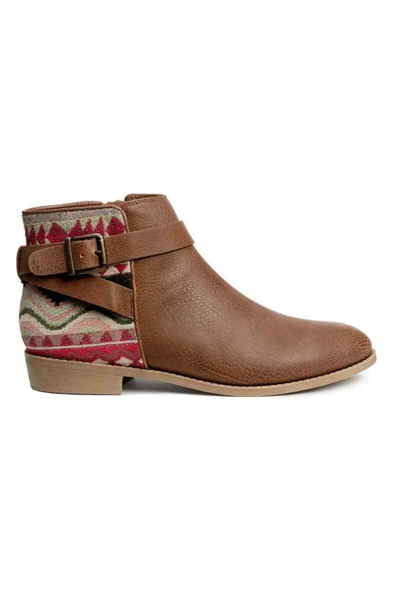 Ankle boots: H&M LOVES COACHELLA. Ankle boots in grained imitation leather with a jacquard-weave section at the back, straps and a zip at the side, fabric linings and insoles and rubber soles. Heel 2.5 cm. The jacquard pattern may vary from pair to pair.