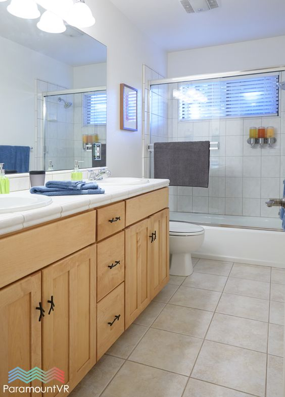Downstairs full bath with dual sinks