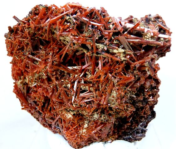 rockon-ro:    CROCOITE (Lead Chromate) crystals with white gibbsite over growth from the Adelaide Mine in Tasmania, Australia.