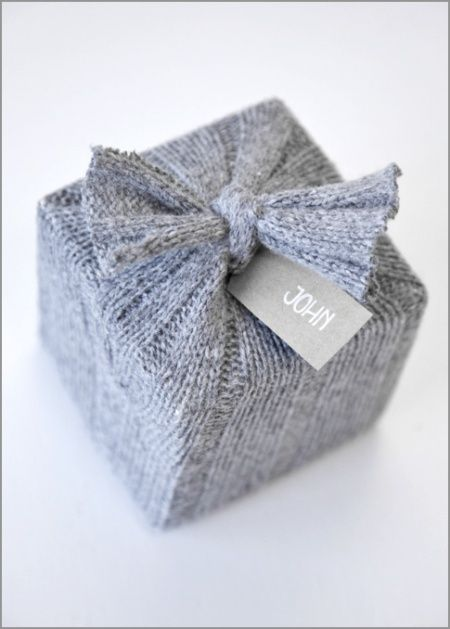 great way to reuse unwearable sweaters (any that cant otherwise be donated for others to wear)...use as cozy Christmas theme gift wrap! this photo is of a package wrapped with the sleeve of an old wool sweater. other really cool DIY projects on the link too.