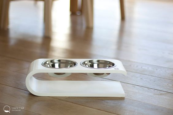 We present our elegant double bowl for your cat or dog. Lazy Cat double feeder can be used for food or water (waterproof material). Elevated