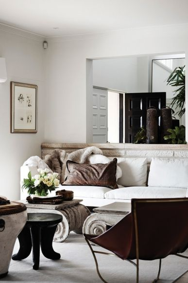 13 homes with perfect floral arrangements: And don't forget about simple white flowers, like these tulips. They work especially well in a neutrally decorated space. Take a full tour of this beautifully layered home.  For more see Vogue Living's 'Floral Styling' Pinterest board.