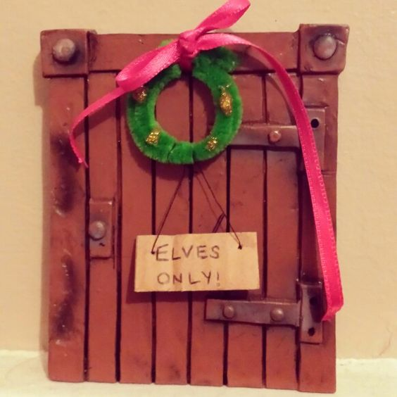 Elf door. Elf on the shelf! Pipe cleaner wreath with an 'Elves Only' sign. It's all about the Christmas Magic.