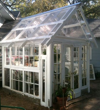 Adorable greenhouse made from salvaged windows and doors for Reclaimed window greenhouse
