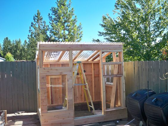 Used Inexpensive Fence Boards For Siding And Stained With