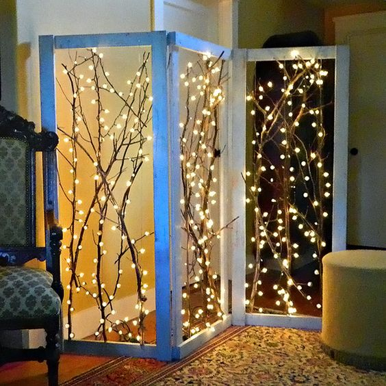 Branch Out! Decorating with Branches • Lots of Ideas & Tutorials! Cool twinkling branches room divider.: