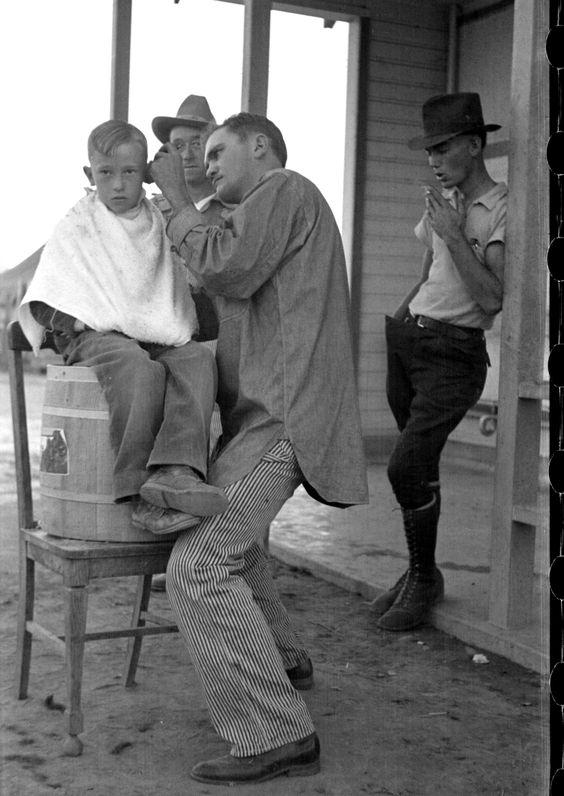 Dorothea Lange, Community barber shop in Kern County migrant camp, California,  1936