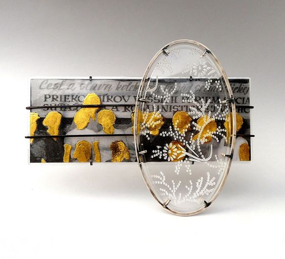 Jana Machatova Brooch: Honour and Praise..., 2014 Plexiglass, silver, paper in laminated plastic, gold foil From collection - 'Where are you from?':