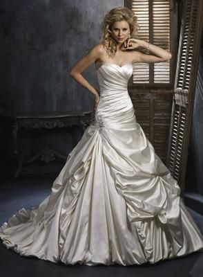 Maggie Sottero Kendra wedding dress has shimmer satin and pretty picks ups for a princess look!