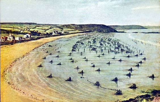 A rare color photograph of the German beach obstacles facing the landing troops. This German photograph was taken before the invasion on one of the bluffs overlooking the beach. On the gray morning of June 6th 1944 this very area would be assaulted.