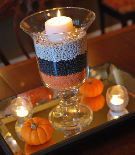 Halloween Centerpiece check it out at www.partylite.biz/HeavenlyAdriana..... Ward halloween party centerpiece- green placemat, small drinking glasses, tealights, pumpkins/ gourds from outside, green lentils, black beans, corn kernels, red beans, white beans