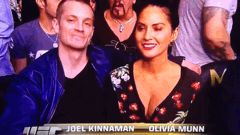 Joel Kinnaman of The Killing and the amazing Olivia Munn from The Newsroom ringside at UFC 168.