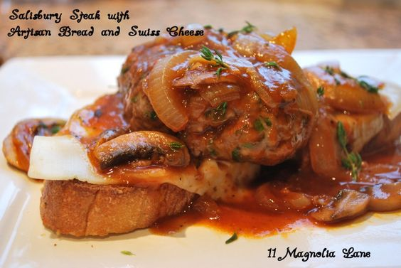 French onion salisbury steak with swiss cheese and artisan bread