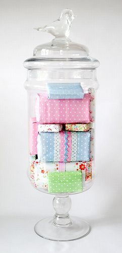 Rewrap hotel soaps in pretty paper and display in jar