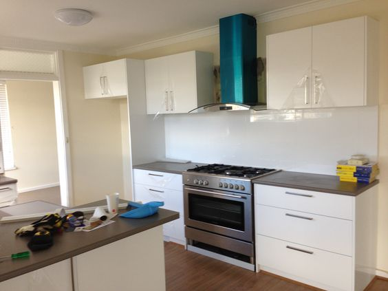 Contempo gloss white vinyl flatpack kitchen cabinets never go out ...