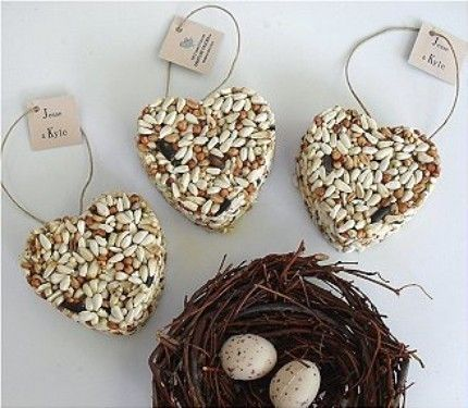 Our bird seed heart favors have been featured in The Knot, Brides, Southern Living, and Family Circle! Perfect for wedding or bridal shower party favors. Use them as indoor decorations, then send them home as favors for your guests hang them outside for the birds.     You will receive 150 heart wedding favors with personalized tags and a free personalized display sign, frame not included. These adorable heart shaped bird seed wedding favors are eco friendly, and hand-made exclusively from…