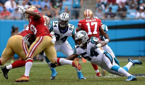 Carolina Panthers linebacker Shaq Thompson, right, reaches out to attempt a…