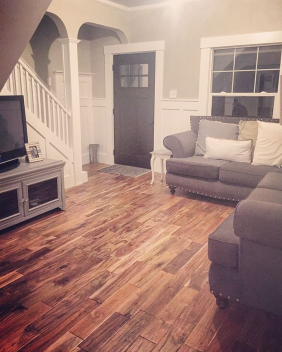 Victorian Farmhouse Remodel. Board and Batten. Acacia hardwood floors. Sherwin Williams Accessible Beige,