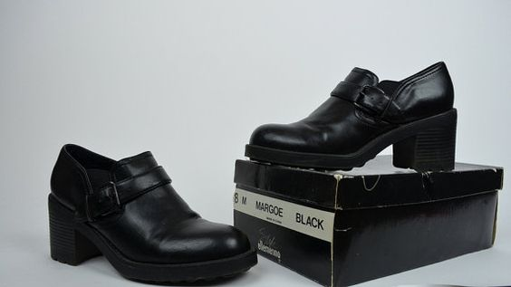 Gorgeous 90s black ankle booties! Deadstock, new with box and original 1996 receipt! Rounded toe,slip on style. Elastic stretch sides. Chunky rubber sole. Vegan leather.  Excellent Vintage Condition  SIZE: 8 LABEL: 8 BRAND: Style, Ellemeno  Measurements: Width: 3.25 Length of sole: 9.5 Heel: 3 Platform: .25  *Any overpayment exceeding $4 USD will be refunded back to your account.  *All items are measured in US inches, Shoes are listed in the US size.  *All Items are carefully over looked…