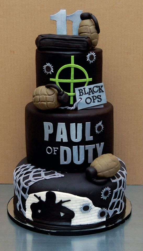 Call Of Duty Cake...I like the black image of the man on the bottom and the hand granades.