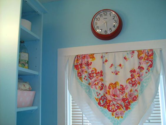 My Vintage Aqua Bathroom with old floral tablecloth, vintage pink striped towel, old aqua painted tall cubbie cubby cupboard. Did the back of the door in AQUA POLKA DOTS Small space bathroom