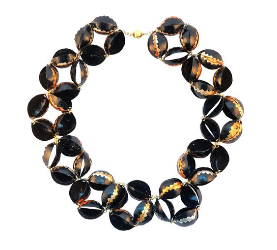 Nolia Shakti Necklace: Black Flowers, 2015 Nespresso capsules, gold plated metal, magnet 7 x 7 x 75 cm Photo by: Jeroen Calon From series: Throw Away Gold: