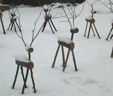 pretty wooden reindeer cover in snow.