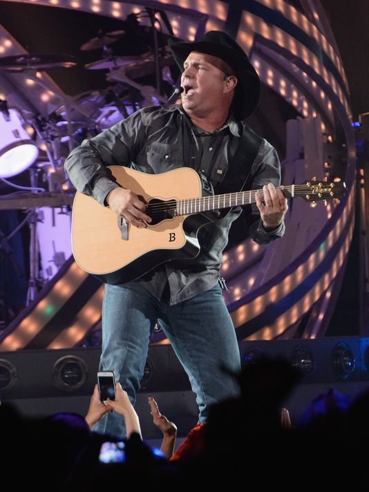 See Garth Brooks in concert.  I was devastated when I did not win tickets to see him play as a kid.  This has been a dream of mine since I was a child.