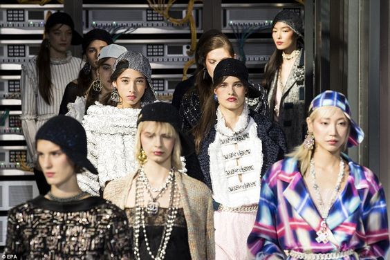 The classic Chanel logo was emblazoned across earrings, jackets, necklaces and some belts ...: