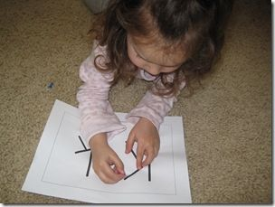 poking holes with a toothpick to make letters/ numbers/shapes- one of my favorite fine motor activities!