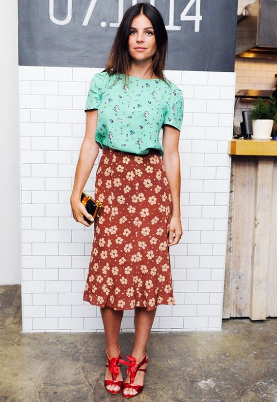 Tuck a botanical blouse into a floral skirt for a flirty and retro feel. // #Fashion:
