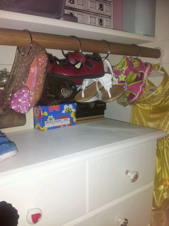 I used shower curtain rings to hang my daughters shoes and saved room on top of her dresser. So fun to choose which shoes to wear now!!!!