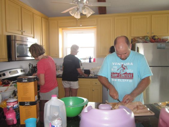 Hard at work cooking at the beach house.