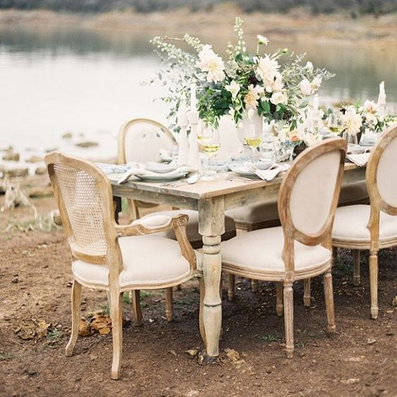 Not only is this #weddinginspiration full of gorgeous #lakeside views, it's also chock full of the prettiest #tablescapes on the planet! #weddingtable | Photography: @kaylabarkerphoto | Design & Floral Design: @the_southerntable | Rentals: @percheventdecor | Table Runner & Ribbon: @silkandwillow