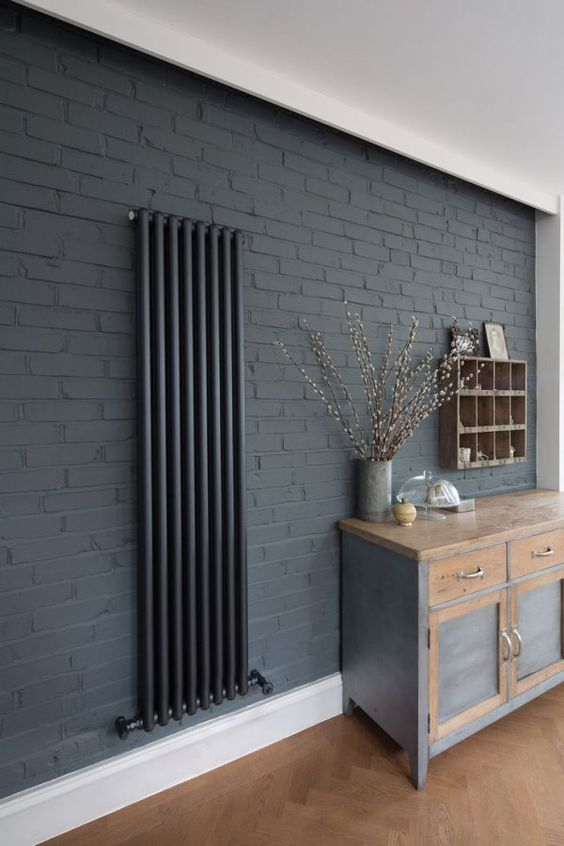 cache radiateur 7 fa ons d int grer le radiateur dans sa d co gris design et murs de briques. Black Bedroom Furniture Sets. Home Design Ideas