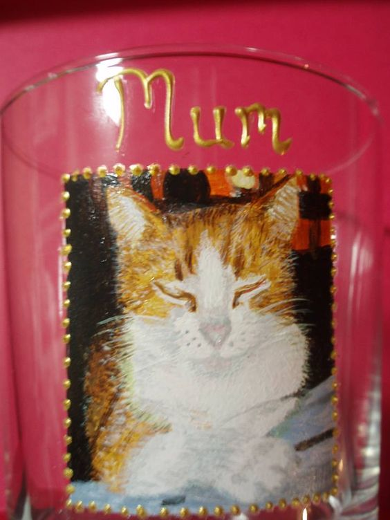Handpainted wine glasses.  painted cat on a glass