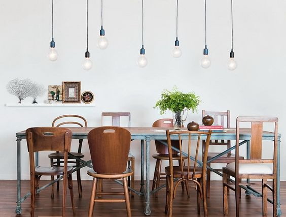 Pendant bulbs / Multiple simple bare bulb pendants over dining table.