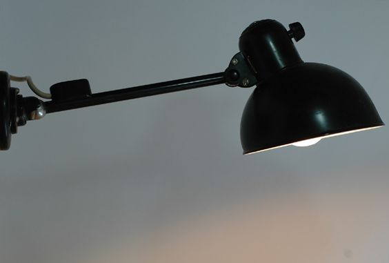 A Kaiser Idell Model 6723 wall lamp, designed in the mid-1930s by the Bauhaus teacher Christian Dell
