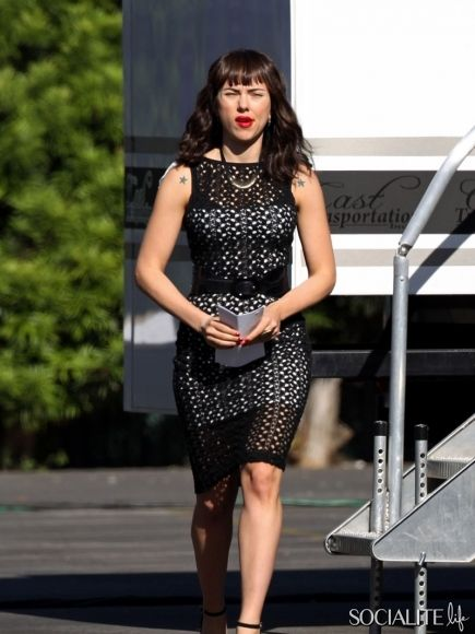 Scarlett Johansson shows off fake tattoos on her shoulders as she changes from short shorts and a tank top into a black dress and heels on the set of her new indie film 'Chef.' July 17, 2013.