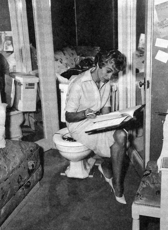 Janet Leigh reading her script while sitting on a toilet on the set of Psycho, 1960, Alfred Hitchcock.:
