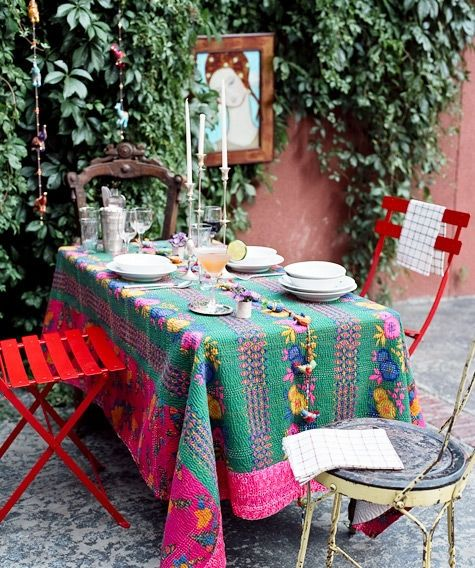 The Boho Table...     The bohemian table always requires a beautiful, worn out, patchy table cloth.  It can be an old quilt, shawl, tapestry, sari or anything really that will lie flat and bring a shot of color and texture to your table.